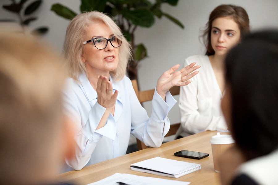 Woman mentoring during a meeting