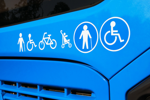 Blue bus with accessibility symbols